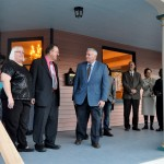 Mayor Summers and the owners of the home at 1436 Grace Avenue cut the ribbon on the extensively renovated, 117-year-old home.