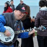 Gary Rice performs the banjo at the special event to celebrate the new the $2 million project that reinvents Lakewood's access to Lake Erie.